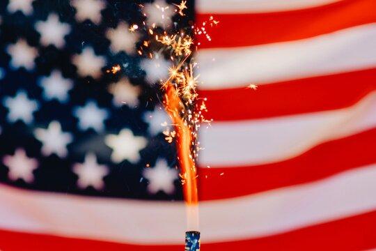 Full Frame Shot Of American Flag With Sparkler