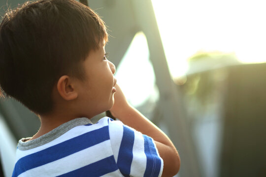 Close-up Of Cute Boy Looking Away Outdoors