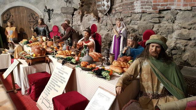 Visegrad, Hungary - May 15, 2018: Royal Banquet from XIV century historical scene from Hungary with wax statues at Wax Museum in Royal Banquet.