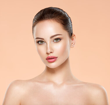 Portrait of beautiful young brunette woman with clean face. Closeup face of young adult woman with clean fresh skin.