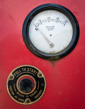 Push to start sign and gauge on old machine 1042