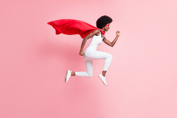 Full length body size view of motivated energetic girl jumping wear hero look running fast isolated on pink pastel color background
