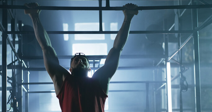 Crossfit Bodybuilder Athlete Working Out Performing Pull Ups At The Gym Active Lifestyle Determination Crossfit Success Concept