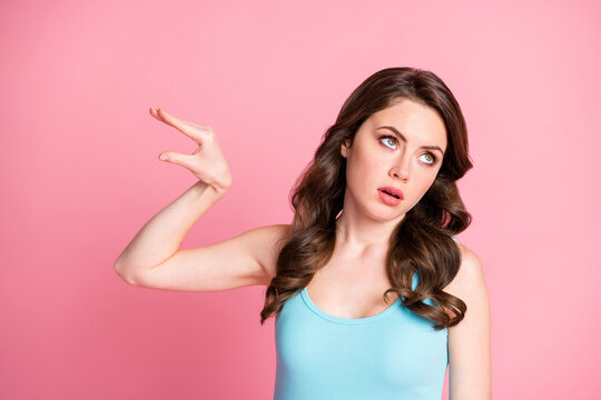 Portrait of ignored sad brunette long hair style girl show bla bla bla sign wear blue top isolated on pink color background