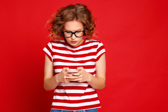 Surprised woman reading message on smartphone