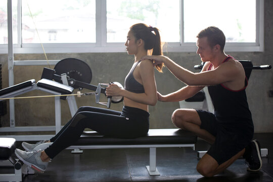 Man Helping Woman In Exercising