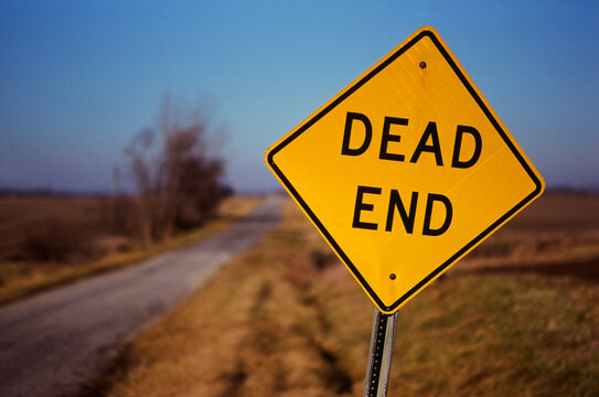 Dead End Sign On A Country Road At Sunset
