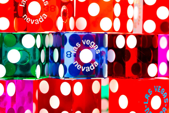 Colorful casino gambling dice from Las Vegas, Nevada on a white background
