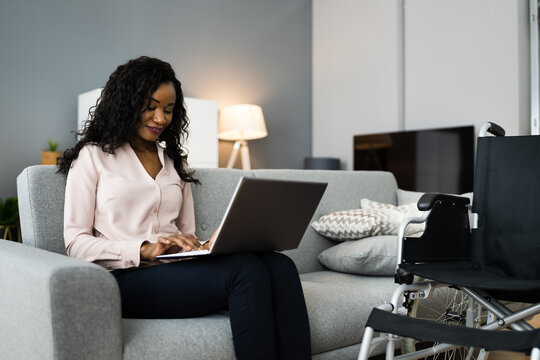 African Woman At Home Using Computer