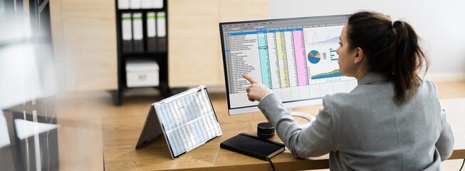 Obraz Woman Using Finance Spreadsheet Report - fototapety do salonu