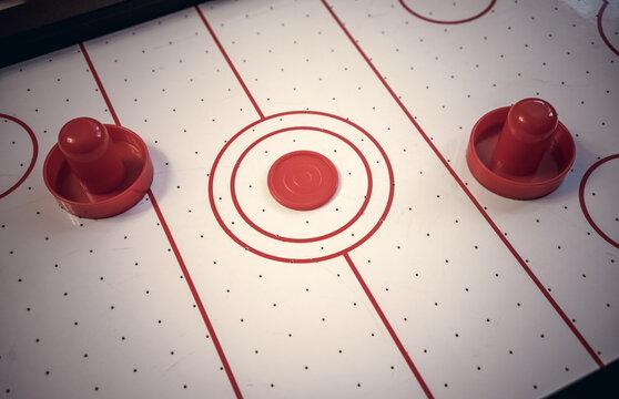 Playing table air hockey at home