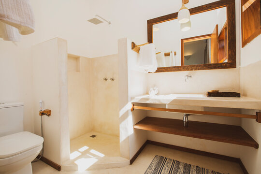 Modern luxury summer holiday or vacation wooden beach house restroom interior with contemporary decoration and furniture