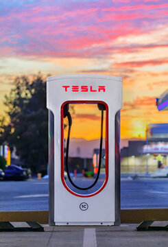 Firebaugh, USA - January 21, 2021: Empty electric Tesla supercharger by California Highway 5 at sunset