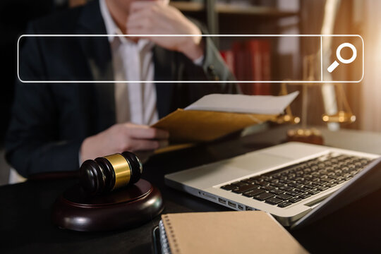 Searching Browsing Internet Data Information Networking Concept with blank search bar.justice and law concept.Male judge in a courtroom with the gavel,working