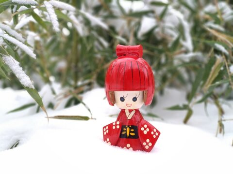 Close-up Of Red Figurine On Snow