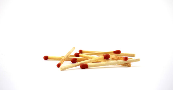Close-up Of Matchsticks Over White Backgrounds