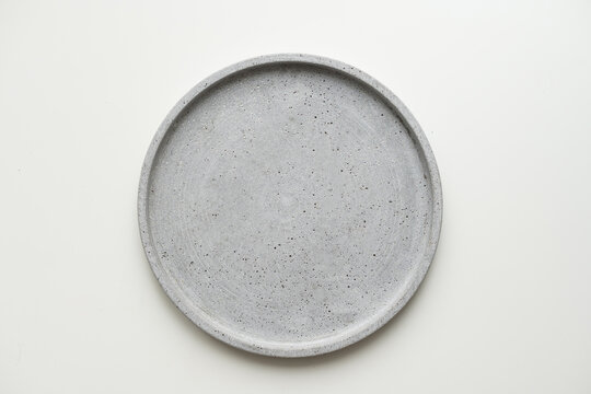 Empty ceramic plate, gray round tray plate isolated on white background with clipping path