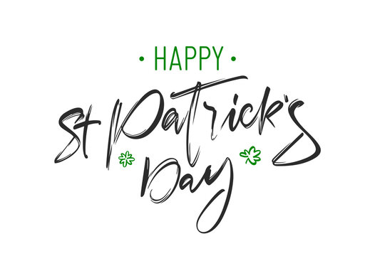 Handwritten brush lettering composition of Happy St. Patrick's Day on white background.