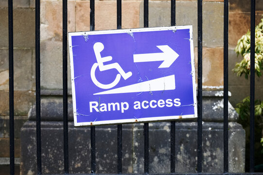 Ramp access for disabled wheelchair users sign at entrance