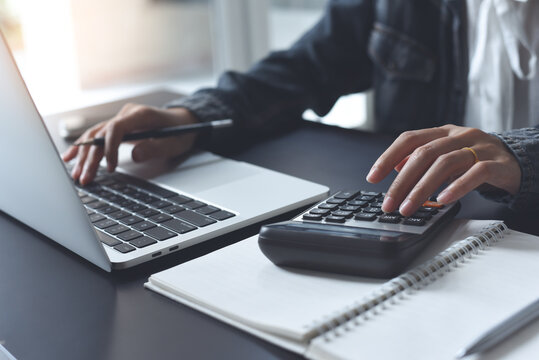 Business and finance concept, Business woman using calculator to calculate business data at office