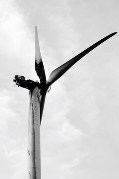 Low Angle View Of Damaged Windmill Against Sky