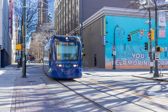 Atlanta, USA - Jan 18th 2021: Blue streetcar in downtown Atlanta, USA