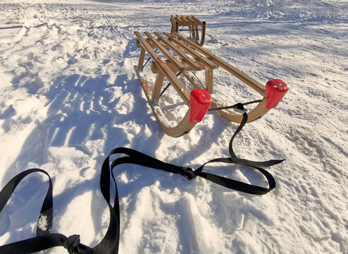 to sleds on snow at a sunny day