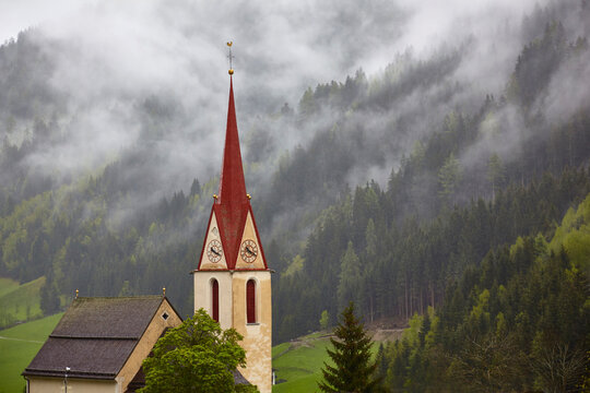 South Tyrol impressions, church in Innerratschings in the early morning fog, (Italy)