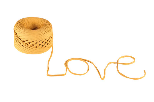 the word love made of knitted yarn on a white background