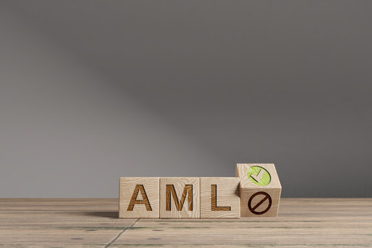 Wood cubes with acronym ''AML' - 'Anti Money Laundering' on a beautiful wooden table, studio background. Business concept and copy space.