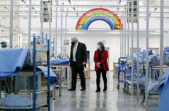 Britain's Prime Minister Boris Johnson visits a PPE manufacturing facility, in Seaton Delaval