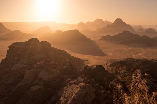 Sunrise above rocky desert