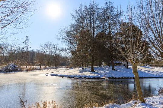 frozen lake in park in Hoogvliet, dutch winter in The Netherlands, February