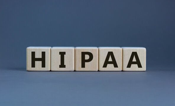 HIPAA, Health Insurance Portability and Accountability Act of 1996 symbol. Words 'HIPAA, Health Insurance Portability and Accountability Act', beautiful grey background. Business concept. Copy space.