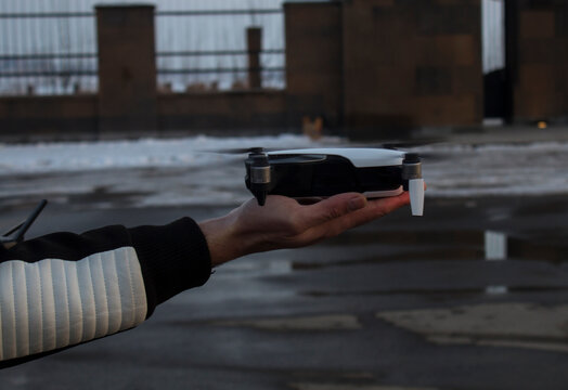 drone and remote control in human hands