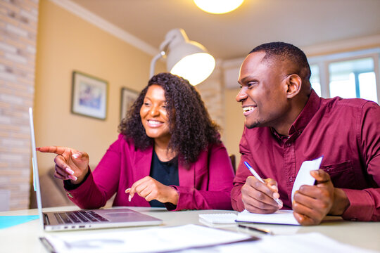 Authentic people african american woman and man in home office in living room start up
