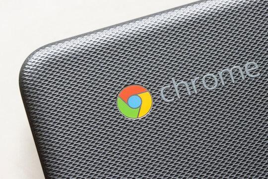 Portland, OR, USA - Feb 4, 2021: Closeup of the Google Chrome logo seen on a Samsung Chromebook 500c isolated on white.