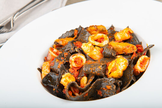 Squid ink pasta with seafood sauce