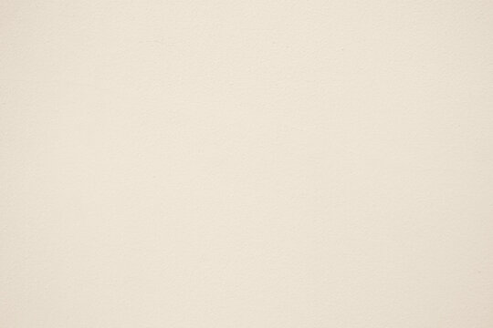 Stucco Wall Texture Background in Antique White Color Tone.