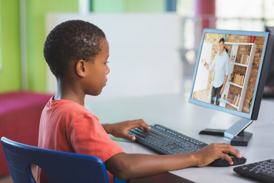 Male african american student having a video call with male teacher on computer at school
