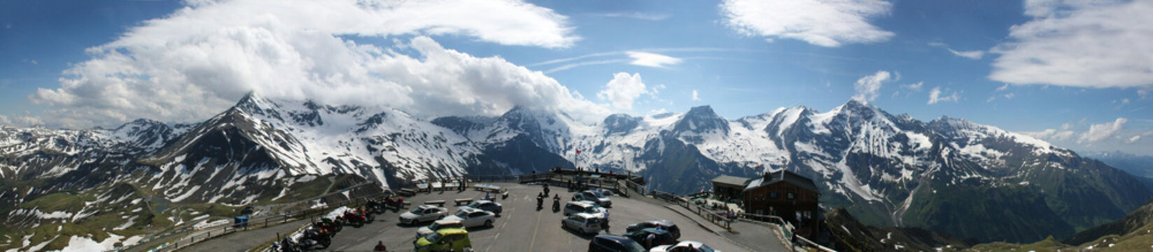"""Großglockner, view from the """"Edelweißspitze"""" onto the parking lot and the Alps, panorama in spring"""