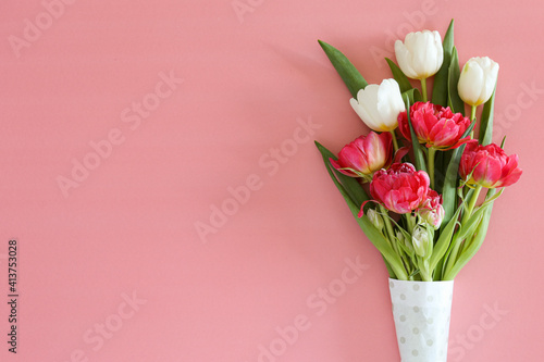 Fresh flower composition, bouquet of different types of tulips, isolated on pink background. International Women's day, mother's day greeting concept. Copy space, close up, top view, flat lay.