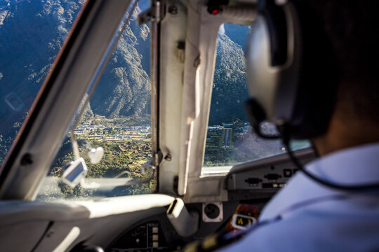 aeroplane cockpit flying in towards lukla airport in nepal