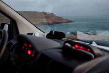 Moody landscape through car window, Faroe Islands Fotobehang