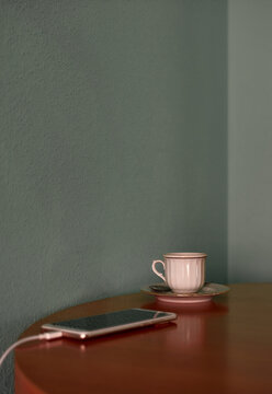 Coffee cup and teapot on a corner table. Conceptual image