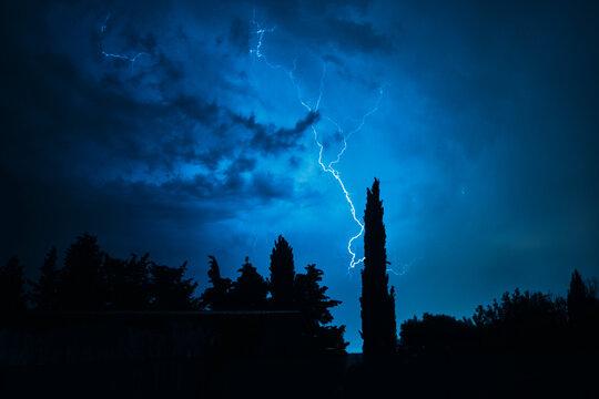 thunderstorm illuminates a dark night