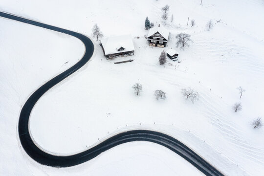 Road winding in the swiss Alps mountains in winter time