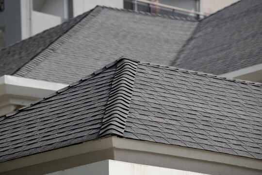 roof shingle background and texture. dark asphalt tiles on the roof.
