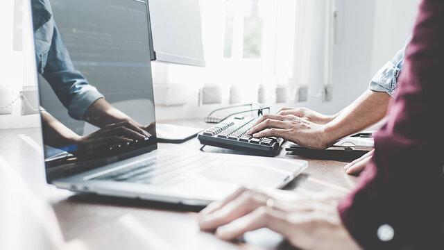 Programmer working in a software development and coding technologies. Website design. Technology concept.