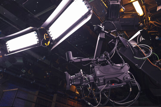 Camera jib and lighting equipment in broadcasting studio